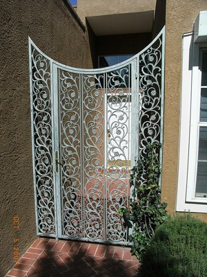 Courtyard gate with side panels in castings design and custom finish