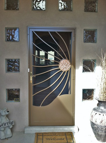 Security pre-hung door with Windblown Copper Sun design