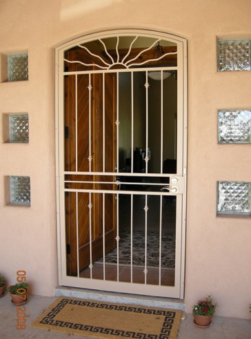 Pre-hung security screen door with Eyebrow top Wavy Sun with Knuckles