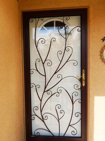 Security storm door in scroll design