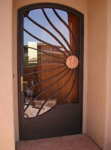 Security Storm Door in Wind Blown Copper Sun an Arched Top