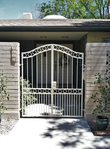 Pair of eye browed top gates with circles and doggy pickets