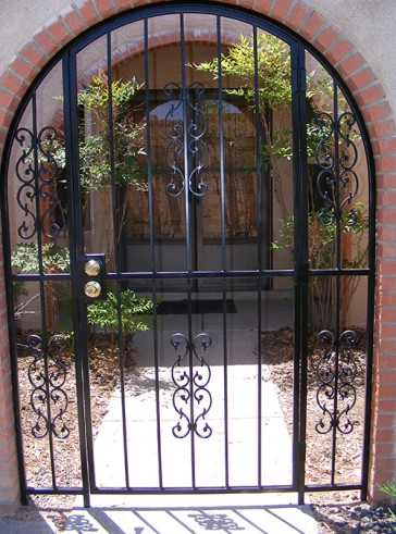 Arched entry gate with Sunbird design