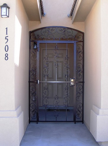 Arched gate with Forged scrolls design