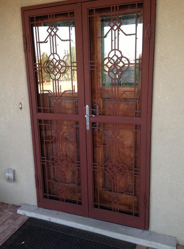 Pair of security storm doors in custom square and circle pattern