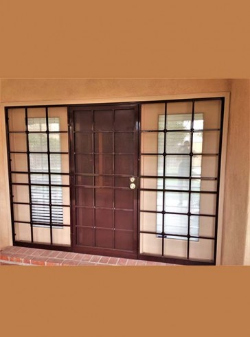 "Security pre-hung door with sidelights in 3/4"" Divided light design and perforated metal on door"