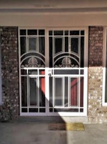Security pre-hung screen door with sidelight in Park Avenue design