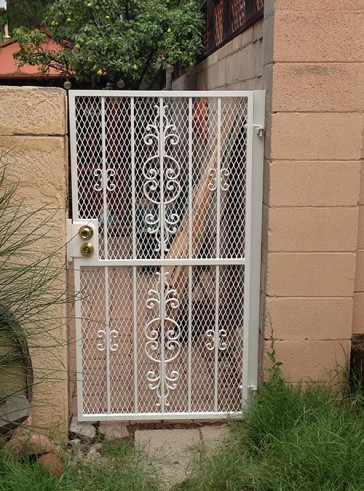Gate with Caprice and C scroll design and expanded metal