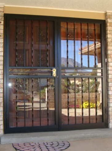 pair of security storm doors with alternating twist design