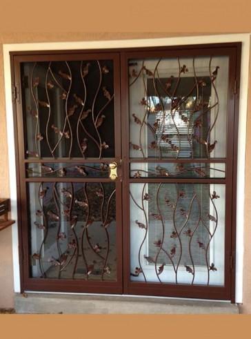Pair of security storm doors in wavy leaf design