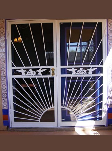 Pair of security storm doors with sunray design and humming birds in the center