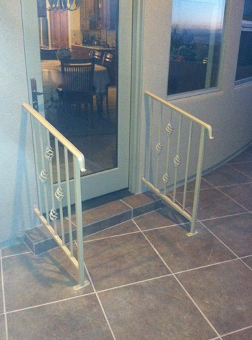 Step railings with moulded cap, lambs tongue ends and Baskets design