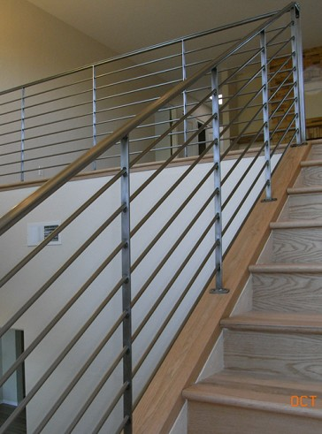 Raw steel railing with round horizontals