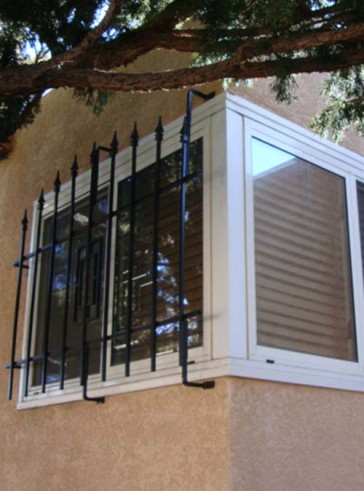 One side of corner window grill with Spears in Contemporary design