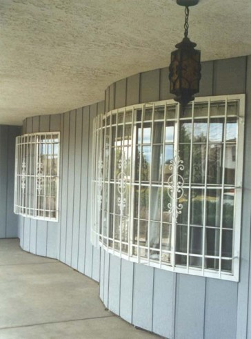 Curved window grill in Caprice design