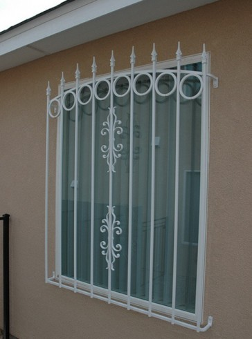 Arched window grill with Spears, Circles, and Sundance design