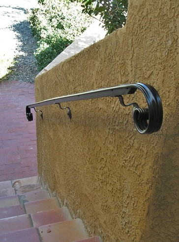 Wall mount railing moulded cap and Volutes
