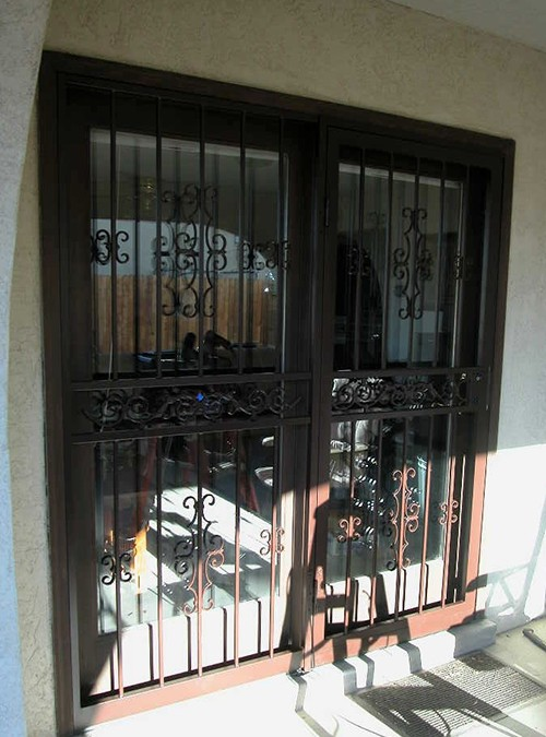 Pr  of pre-hung screen doors in Seville with single side scrolls design