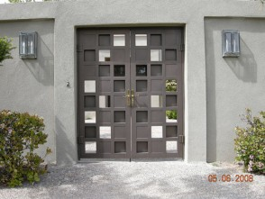 Pr. of double entry gates in Custom grid pattern with random solid panels.