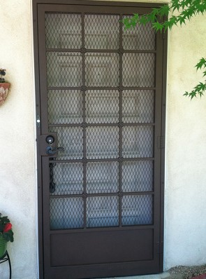 "Security pre-hung screen door in 3/4"" Divided Light with Cross Strap design, kick panel and expanded metal"