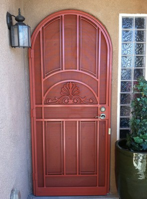 Arched security pre-hung door with Park Avenue design and perforated metal