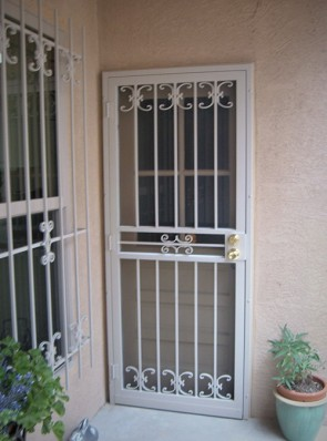 Security pre-hung screen door with medium C scroll design