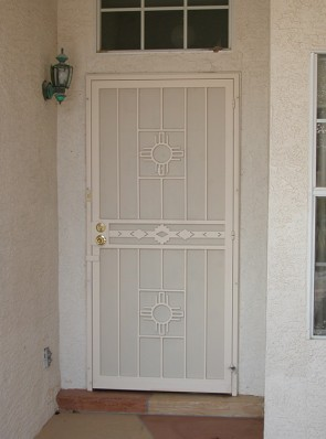 Security pre-hung door with Zia and High Desert design and perforated metal
