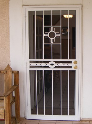 Security pre-hung screen door with Zia on top and High Desert design in center
