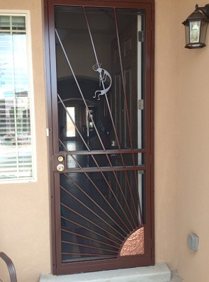 Security screen door with Copper Sunray and Kokopelli design