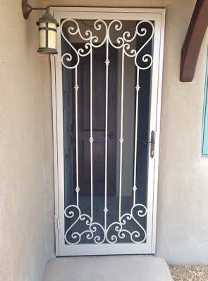 Security screen door with Slimline lock, and Forged scrolls top and bottom and Knuckles design