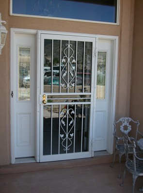 Security storm door with Forged Leaf scrolls and Twist in center