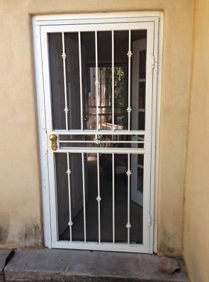 Security storm door in Knuckles design