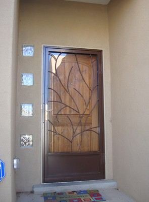 Security storm door in Bare branches design with kick panel