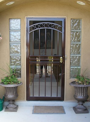 Security storm door with arched Circle design on top and brown color