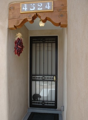8' high security storm door in High Desert design with Zuni bear on bottom