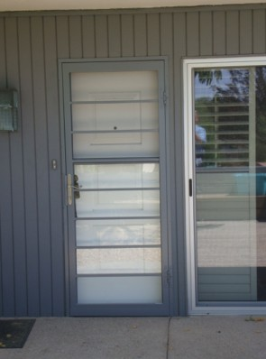 Security storm door in horizontal pickets design