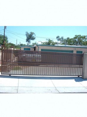 Sliding gate with High Desert design and perforated metal