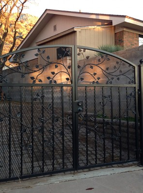 Double gates with leaf design and expanded metal on bottom