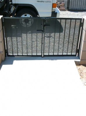 Double gates with double cane bolts and perforated metal