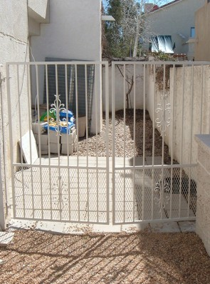 5' high double gates with sundance design and expanded metal on bottom