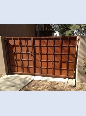 Offset center pr. of gates with overlapping Divided Light design and solid metal in rust finish