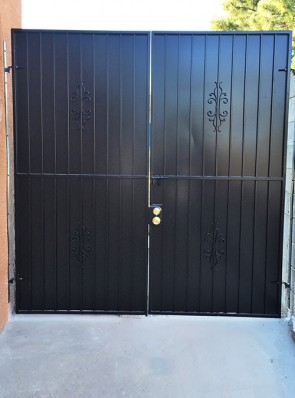 Double gates with Sundance design and solid metal on back