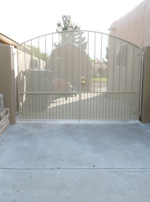 Arched pr. of gates with doggie pickets, and perforated metal