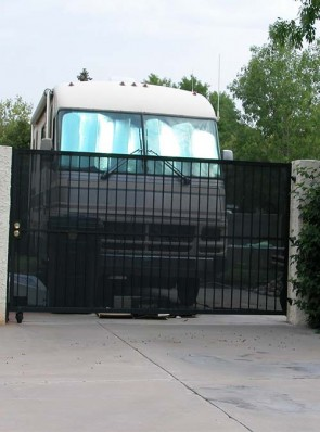Single driveway gate with perforated metal
