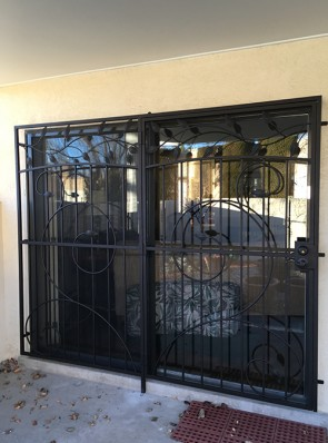 Patio door with large scroll design with leaves on top