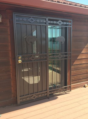 Patio door with High Desert design and Zuni Bear on top