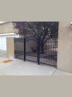 Arched gate with side rails in C scroll design and spears