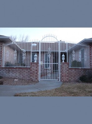 Front entryway arched gate with spears and Caprice design