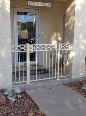 Gate and railing with Castle Rock design
