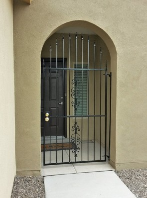 Arched gate with Spears and Caprice design